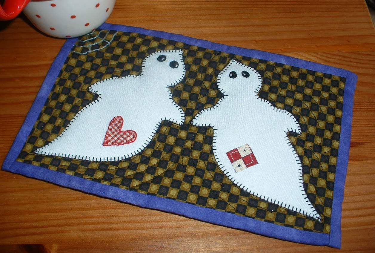 http://www.craftsy.com/pattern/quilting/home-decor/ghostly-duo-mug-rug/59473