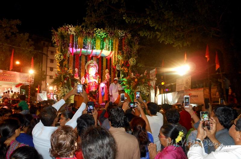 Clicking Ganesha during the festival of Ganesh Visarjan, Mumbai