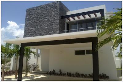 fachada de casa contemporanea con aplicaciones de piedra decorativa