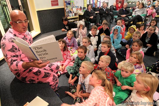 Marty Hantz, principal at Taradale Primary School, Taradale, Napier, reading to a group of kids, back at school for a Milo and Marshmallow Night. photograph