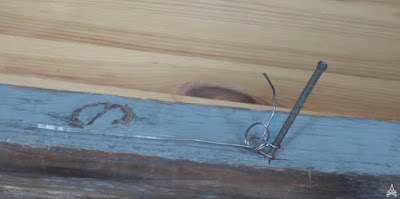 Demonstration of timber hitch tied using wire to a nail