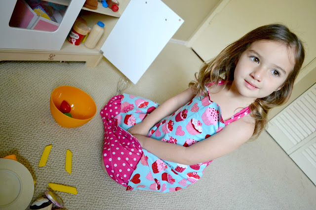 Kayla wearing her little girls apron style cupcake dress from Zulily #cbias