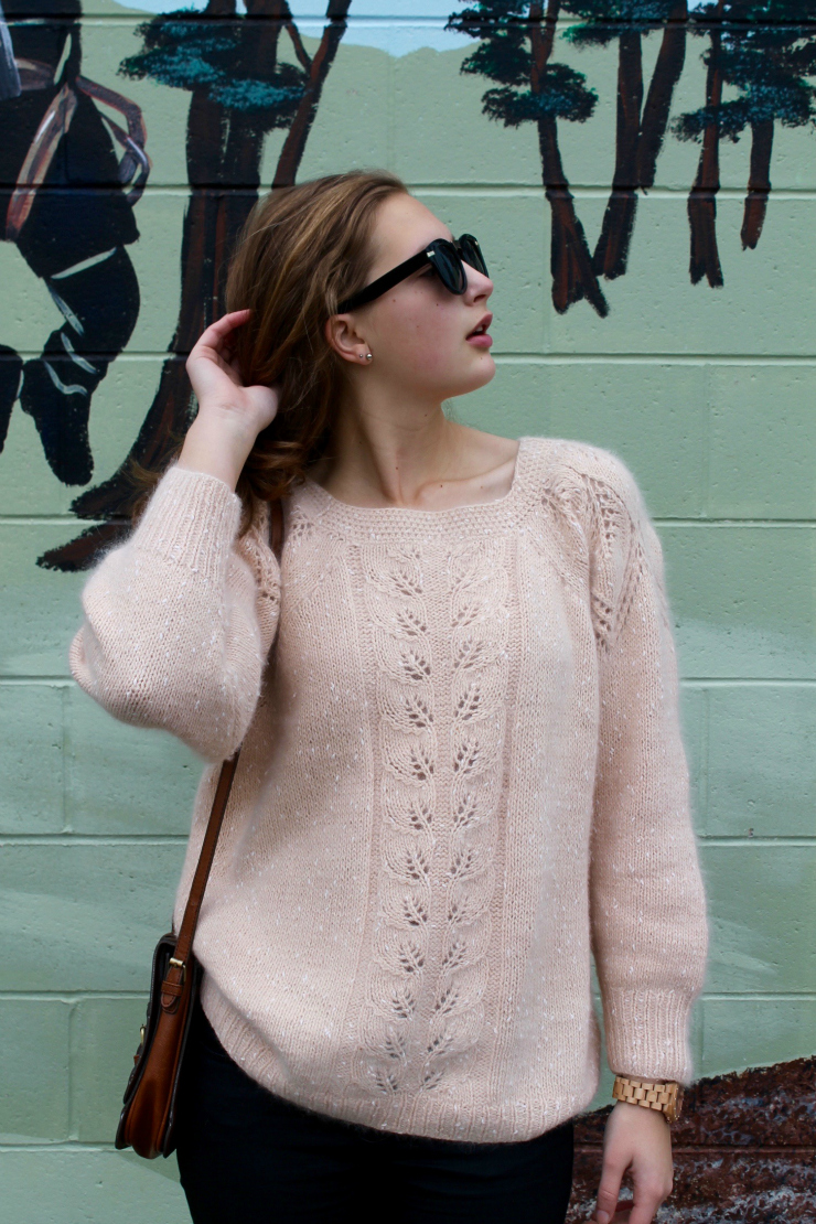 Peach colored angora sweater, black skinny jeans and classic woooden watch