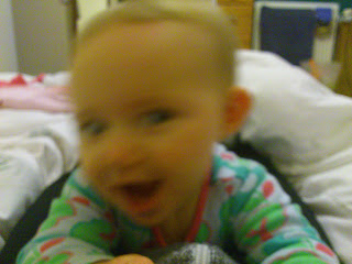 blurry photo of baby with cheeky grin