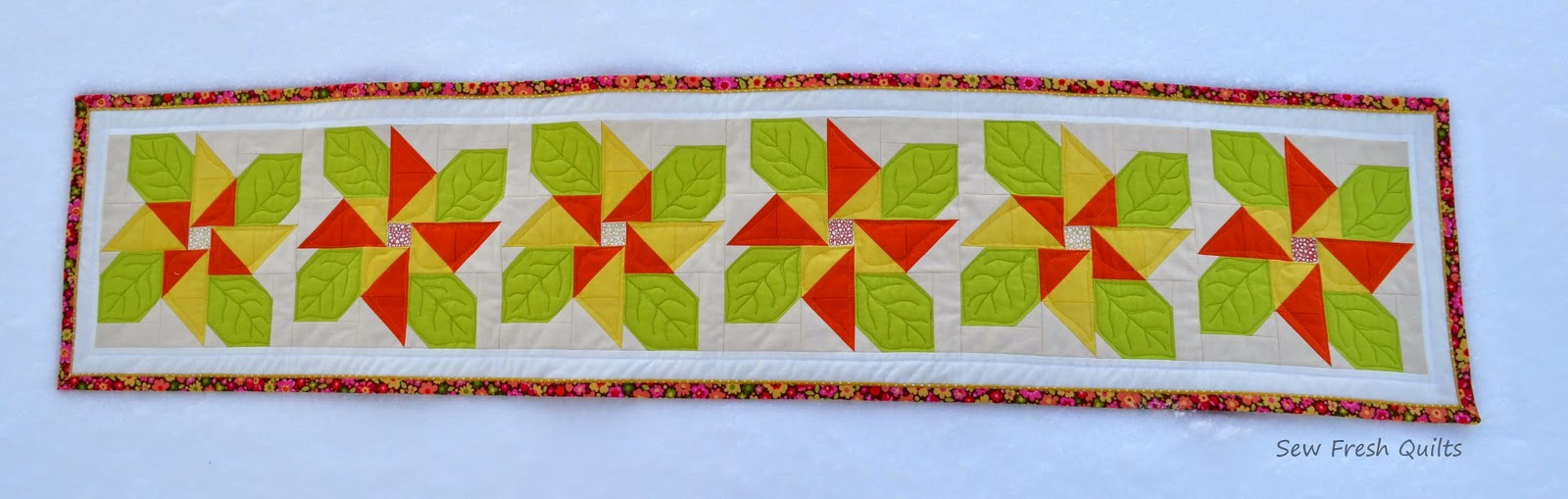 http://sewfreshquilts.blogspot.ca/2015/01/flowering-table-runner.html