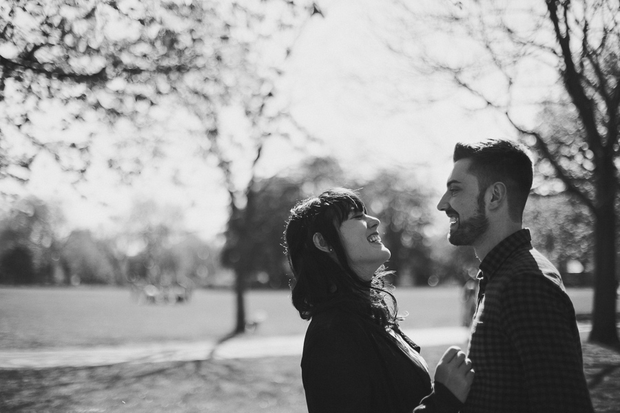 Couple laugh together at the park in the afternoon