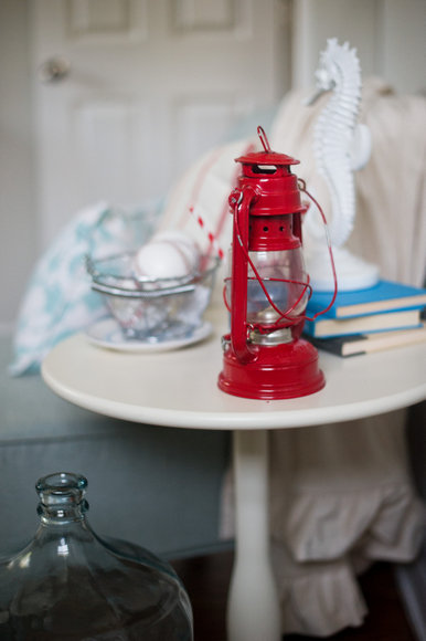 This vintage red lantern adds to the lodge themed guest room.