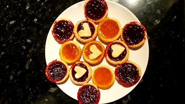 Homemade raspberry and apricot jam tarts