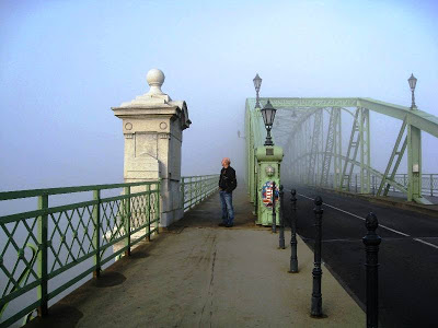 Mr A on a bridge in the mist