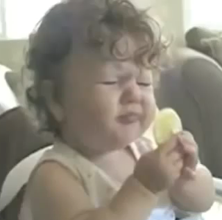 babies expression face when eating lemon