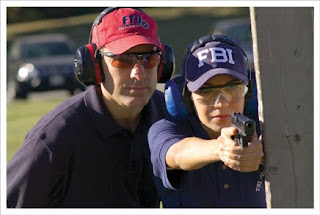 FBI agent in training on the gun range.