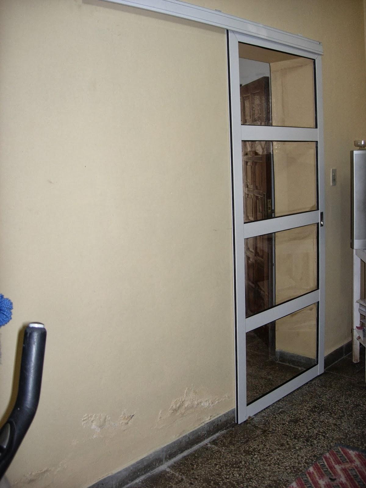 Via dise o carpinter a de aluminio puerta colgante - Puerta balconera aluminio ...