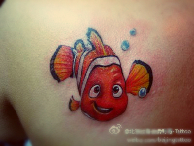 The little fish tattoo on the chest from movie Finding Nemo