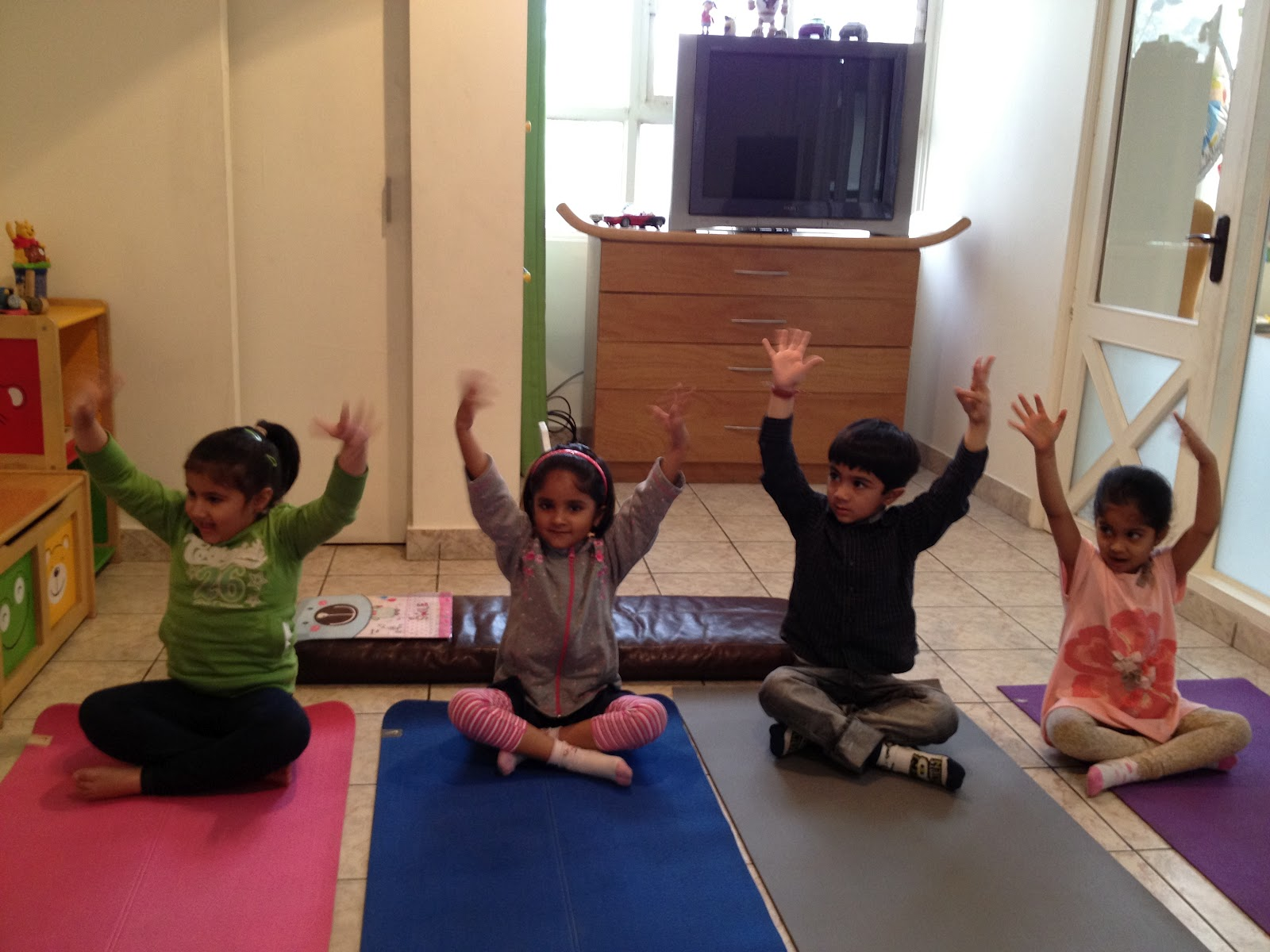 Room to grow space to learn kids yoga session for Living room yoga sessions