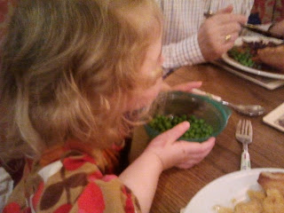 Toddler eating peas
