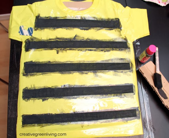 Bumble bee costume tutorial inexpensive no sew creative green allow the paint to dry or mostly dry if you are impatient like i am before peeling away the packing tape keep the cardboard inside the shirt until it is solutioingenieria Choice Image