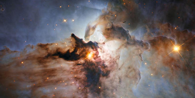 This new NASA/ESA Hubble Space Telescope image shows the Lagoon Nebula, an object with a deceptively tranquil name. The region is filled with intense winds from hot stars, churning funnels of gas, and energetic star formation, all embedded within an intricate haze of gas and pitch-dark dust.  Credit: NASA, ESA, J. Trauger (Jet Propulson Laboratory)