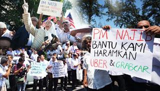 500 pemandu teksi berarak ke Parlimen bantah Uber, Grabcar