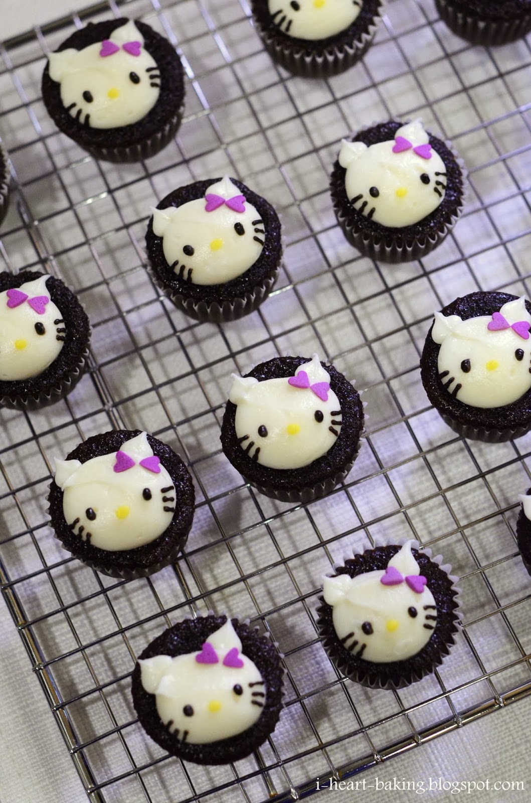 i heart baking hello kitty mini cupcakes with purple bows