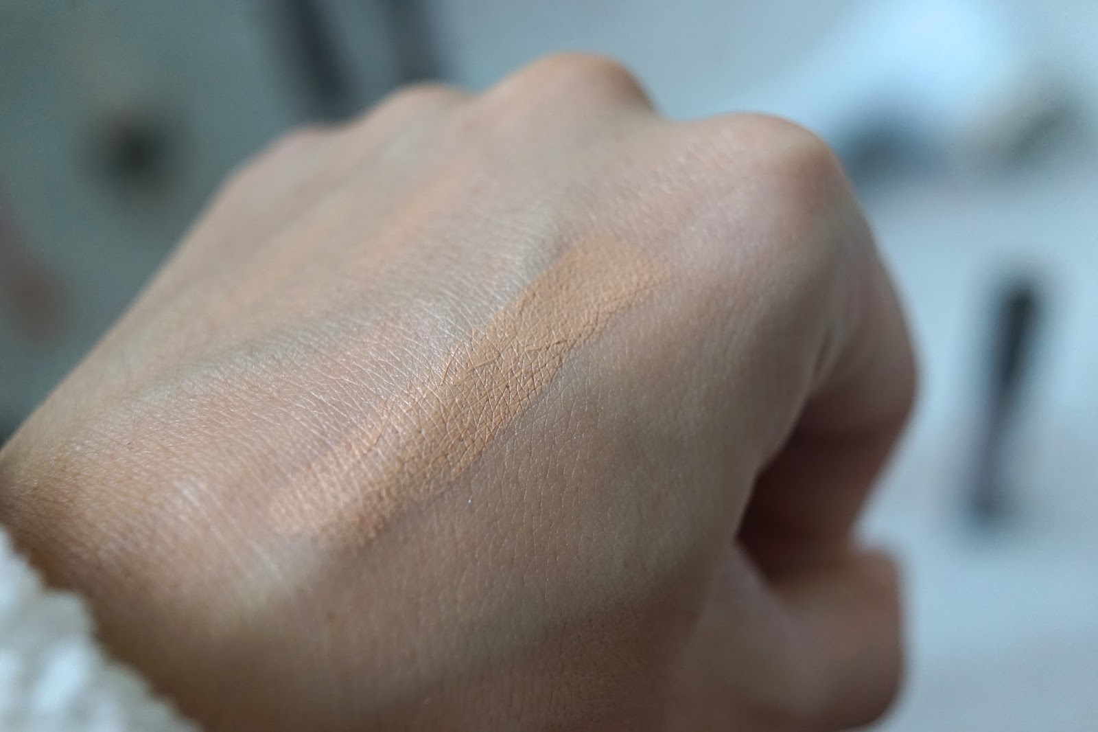 delilah farewell concealer swatch