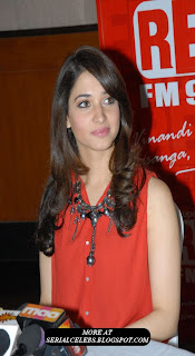 Tamanna in red sleeveless dress
