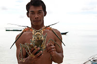 fisherman with a lobster
