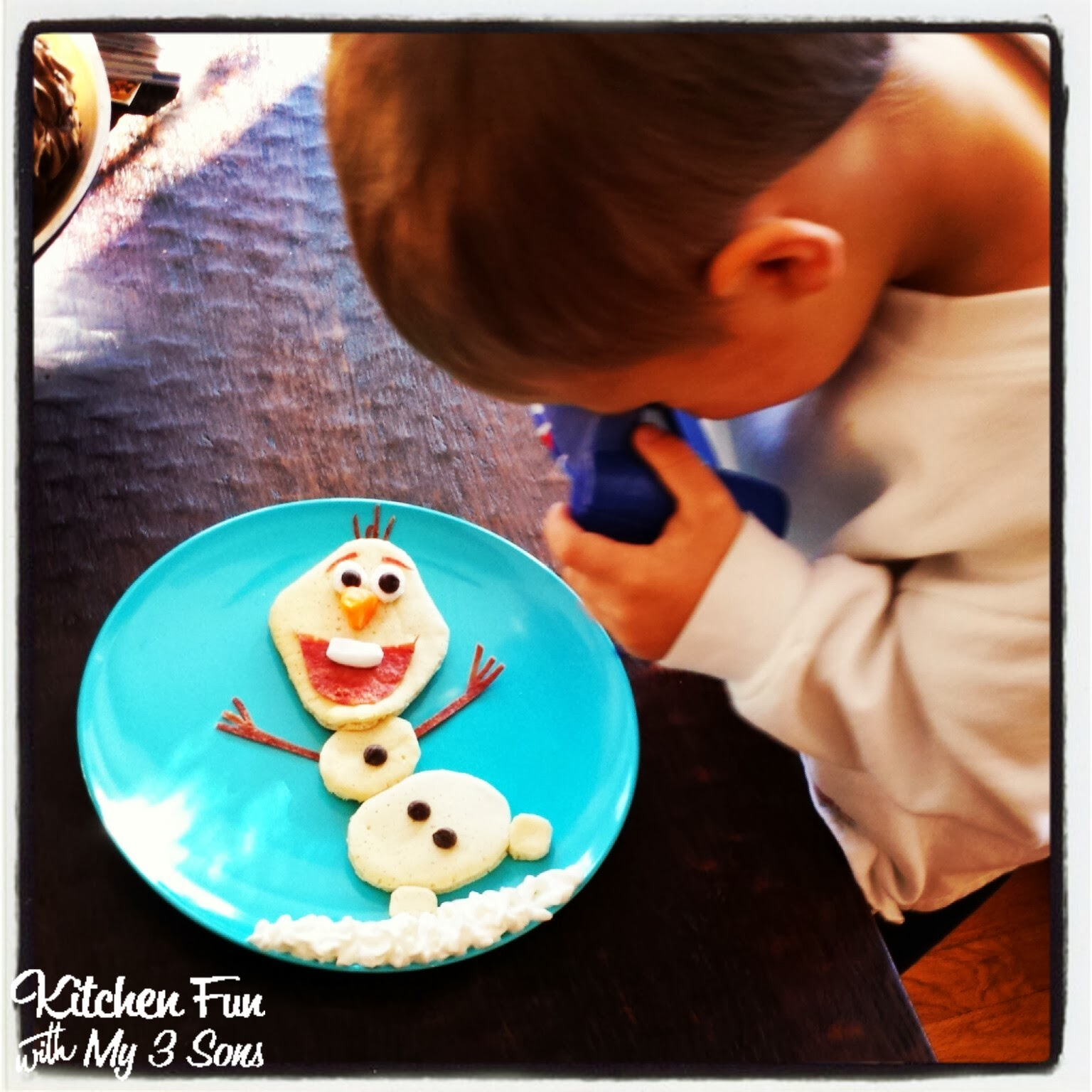 He was so excited to get his olaf pancakes amp couldn t stop smiling at