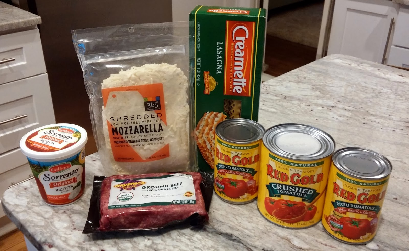 Weeknight lasagna recipe ingredients - ricotta, mozzarella, beef, noodles and Red Gold tomatoes