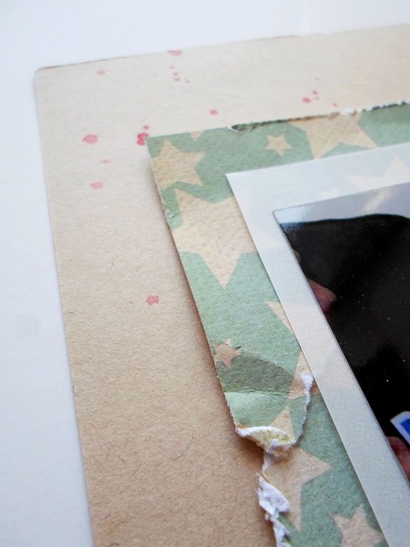 Distressing scrapbook paper layers