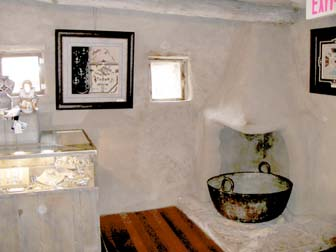 Interior Of Hopi House. Authentic Adobe Fireplace Next To A Showcase Of Native  American Turquoise Jewelry.