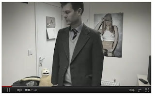 screenshot of man in old office