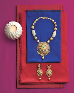 gold jewellery on emi TBZ