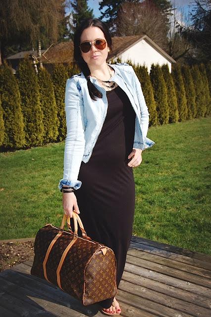 Black maxi dress, jean jacket and a Louis Vuitton Keep All.