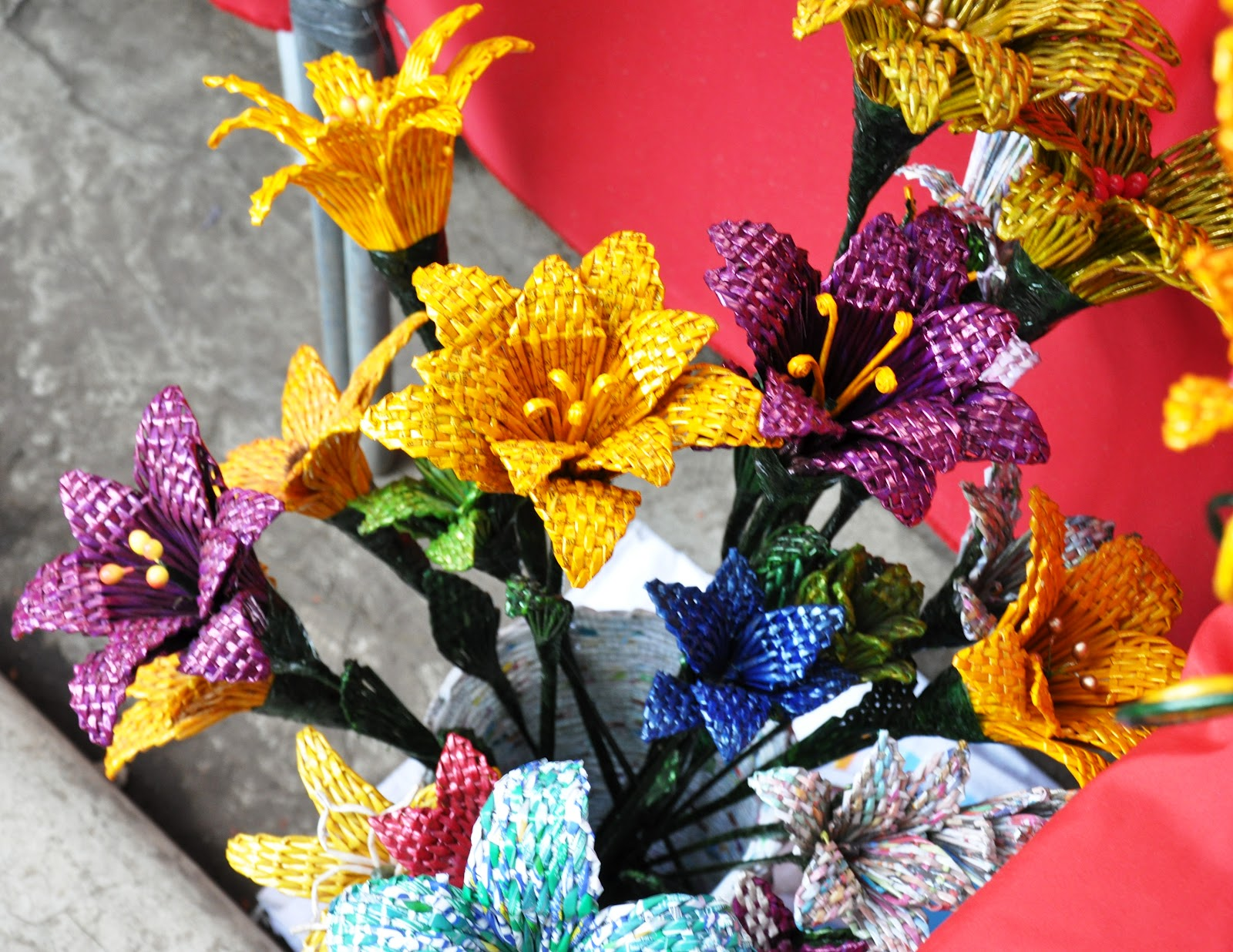 Recycled flowers made of paper and plarn reduce reuse recycle strips of paper are rolled then woven to create various flowers like roses tulips lilies and a lot more mightylinksfo
