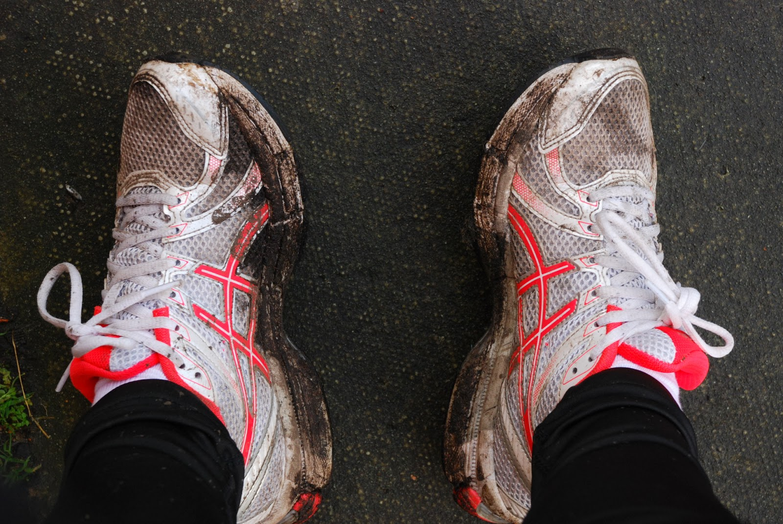 image of running shoes covered in mud