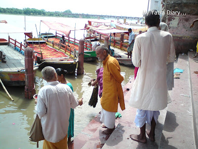 Pilgrims praying at the Yamuna River Ghat, Mathura