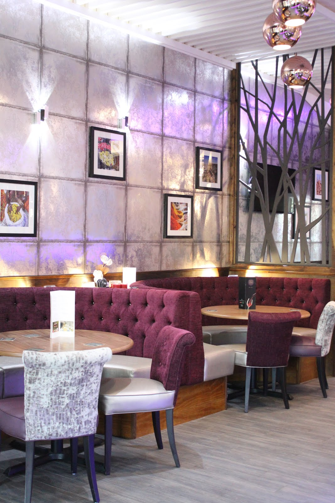 of free parking right outside while inside the contemporary interior design features cool tones of silver and purple as well as eye catching lighting