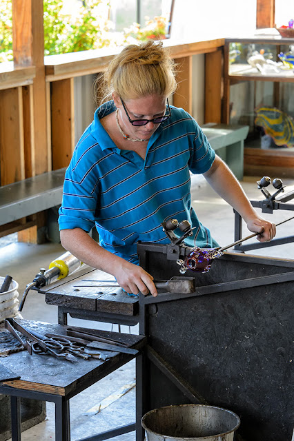 Amy works on a fish at Golden Glassblowing Experience