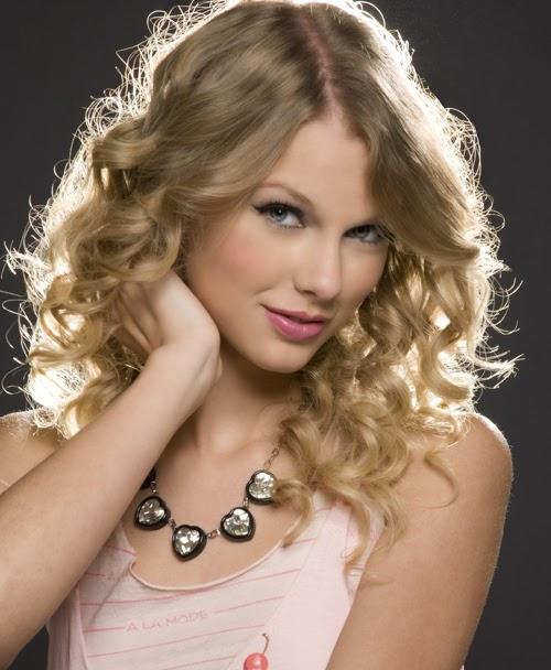 Taylor Swift wearing a Jenny Dayco necklace