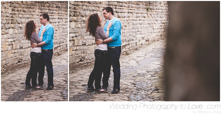 engaged couple on cobbled streets pose for pre wedding photos