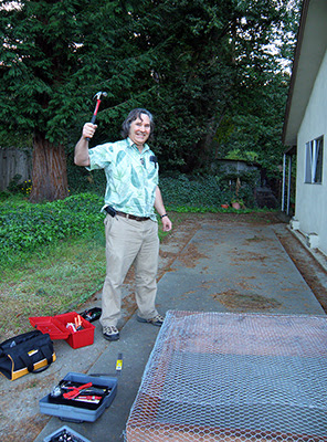 Bruce Posing with Hammer After Making Raised Bed
