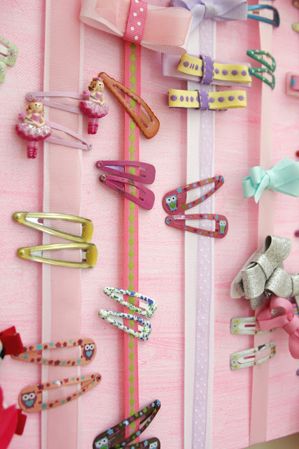 close-up of ribbon and canvas hair accessories organizer