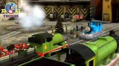 Train Henry and Percy Thomas the tank engine friends delivered Christmas colored lights and ribbons