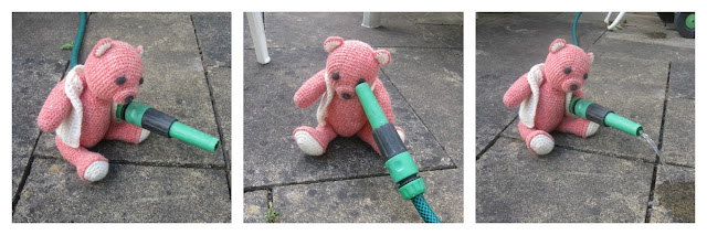 Fiddly Fingers crochet bear Taffy holding hosepipe watering patio