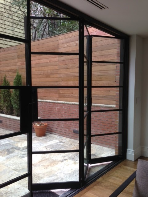 Portella projects manhattan brown stone steel bi fold for Folding french doors