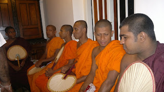 A set of buddhist monks receiving alms giving
