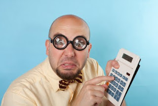 Nerdy accountant with calculator
