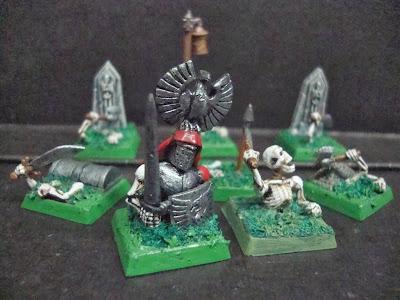 Esqueletos saliendo de sus tumbas