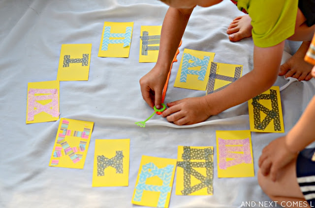 Hands-on math activity for kids: learning about clocks, telling time, and Roman numerals from And Next Comes L