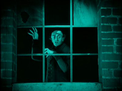 Count Orlok Looks through the window opposite Hutter's House, Nosferatu , F. W. Murnau
